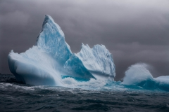 Landscape-Antartica-iceberg-wave-timing-blue-ice-john-greengo