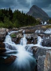 Landscape-many-glacier-montana-waterfall-john-greengo