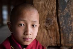 People-Bhutanese-boy-young-monk-john-greengo