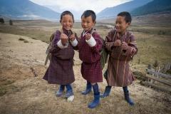 People-Bhutanese-boys-three-kids-laughing-john-greengo