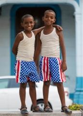 People-Cuban-boys-smiling-hugging-john-greengo