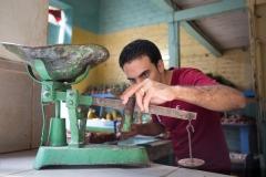 People-Cuban-man-measuring-on-scale-john-greengo