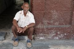 People-Cuban-man-smiling-in-doorway-john-greengo