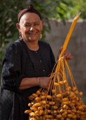 People-Egyptian-Woman-picking-vegetables-smiling-John-greengo
