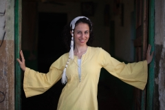 People-Egyptian-woman-standing-in-doorway-smiling-john-greengo