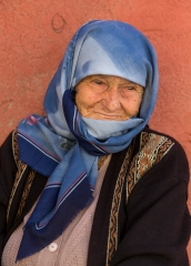 People-Elderly-Turkish-woman-in-blue-scarf-smiling-john-greengo