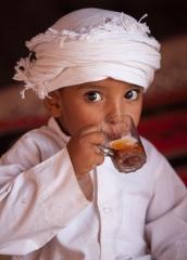 People-Jordanian-boy- sipping-drink-from-glass-john-greengo