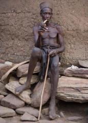 People-West-African-Man-Smoking-on-pile-rocks-john-greengo