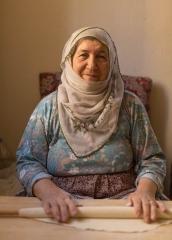 People-elderly-Turkish-woman-rolling-dough-with-rolling-pin-john-greengo